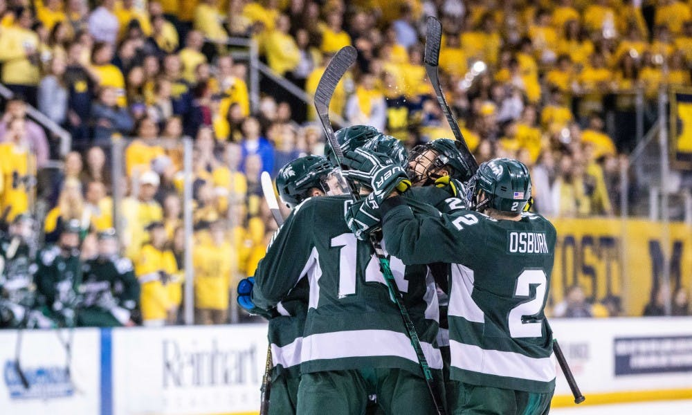 <p>The Spartans celebrate a goal during the game against Michigan on Feb. 8, 2019 at Yost Ice Arena. The Spartans fell to the Wolverines, 5-3.</p>