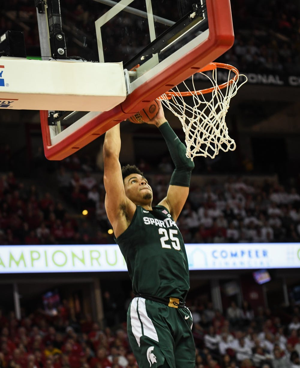 <p>Freshman forward Malik Hall (25) goes up for a dunk during the men&#x27;s basketball game against Wisconsin at the Kohl Center in Madison, Wisconsin on February 1, 2020. The Spartans fell to the Badgers 63-64.</p>