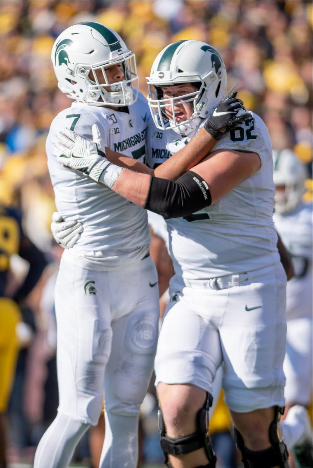 <p>Then-junior wide receiver Cody White (7) celebrates with then-junior offensive lineman Luke Campbell (62) during the game against Michigan Nov. 16, 2019 at Michigan Stadium. The Spartans fell to the Wolverines, 44-10.</p>