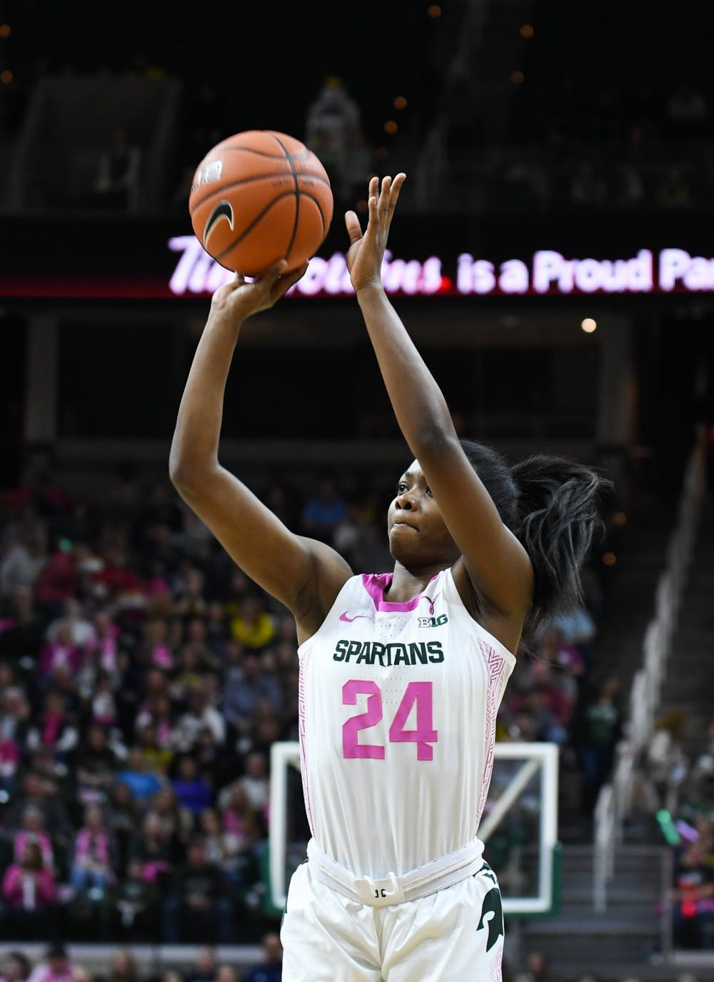 Sophomore guard Nia Clouden (24) takes a shot during the women's basketball game against Michigan at the Breslin Center on February 23, 2020. The Spartans fell to the Wolverines 65-57.