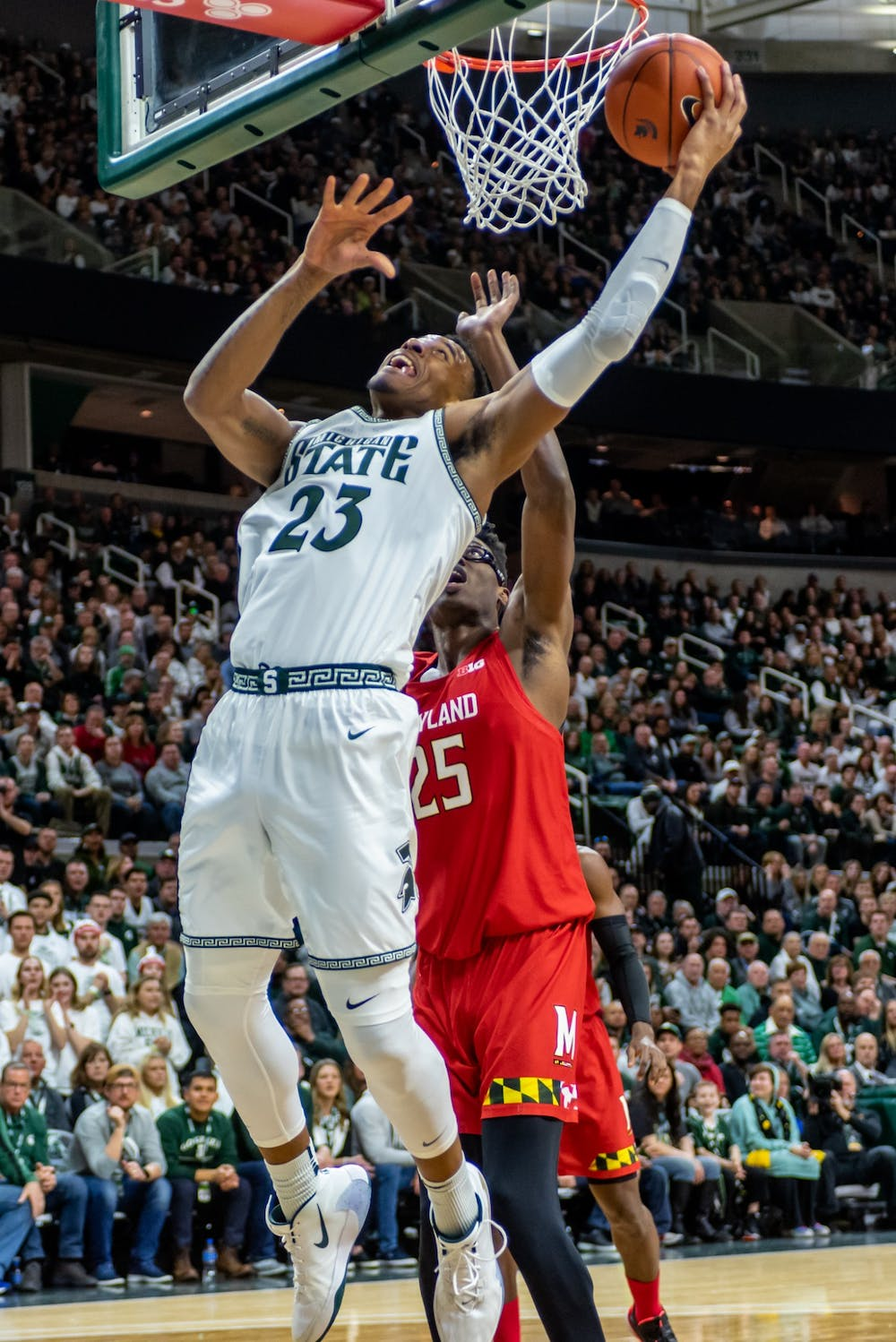 <p>Then-junior forward Xavier Tillman (23) shoots a layup while Maryland's Jalen Smith defends him (25). The Spartans fell to the Terrapins, 60-67, at the Breslin Student Events Center on Feb. 15, 2020. </p>