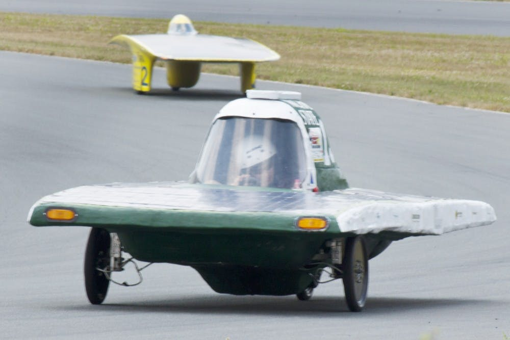 A member of the MSU solar car team drives on a track on July 12, 2012 at Monticello Motor Club in Monticello, N.Y. during the 2012 Formula Sun Grand Prix. Courtesy Photo by Diane Thach