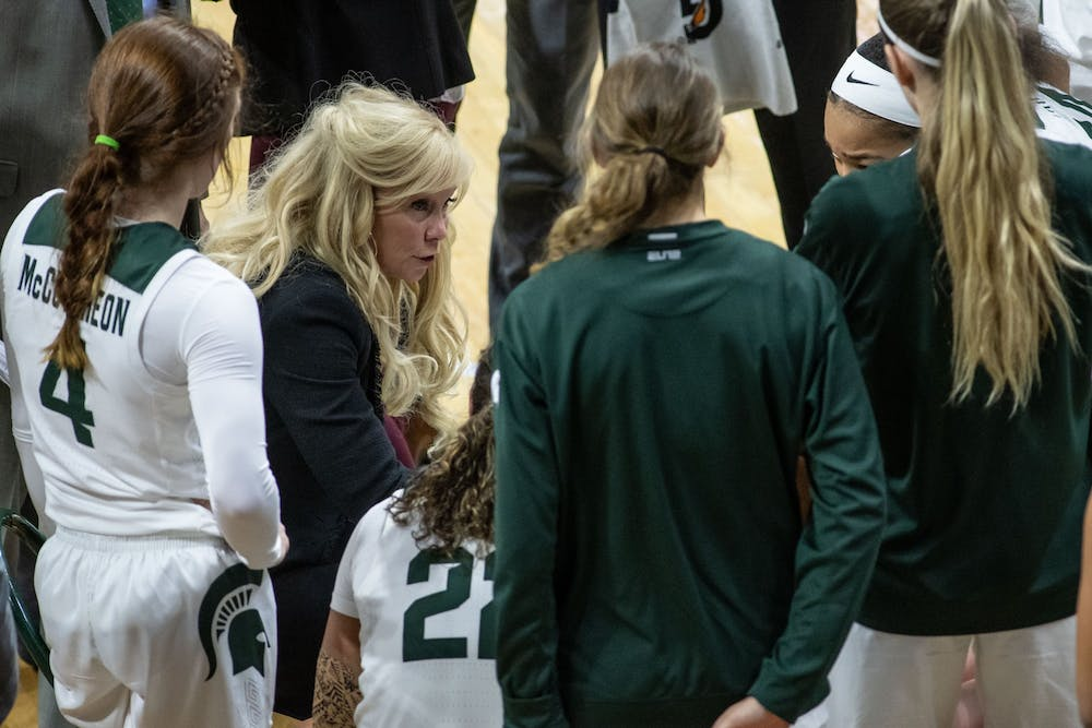 <p>Head Coach Suzy Merchant talks in a huddle during the game against Northwestern on Jan. 23, 2020 at the Breslin Center. The Spartans fell to the Wildcats, 76-48.</p>