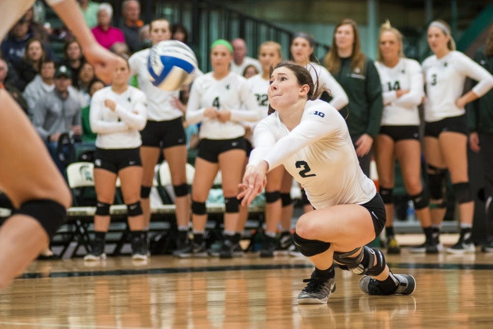 Redshirt junior outside hitter Autumn Bailey (2) bumps the ball during the first round of the NCAA Championship against Fairfield University on Dec. 2, 2016 at Jenison Field House. The Spartans defeated the Stags, 3-0.