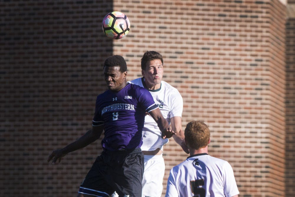 Junior defender Jimmy Fiscus (3) and Northwestern forward Elo Ozumba (9) head the ball during the game against Northwestern on Oct. 22, 2016 at DeMartin Stadium at Old College Field. The Spartans defeated the Wildcats, 2-1.
