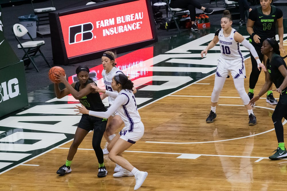 <p>Nia Clouden (24) guards the ball in the Spartans&#x27; game against Northwestern University on Feb. 7, 2021.</p>