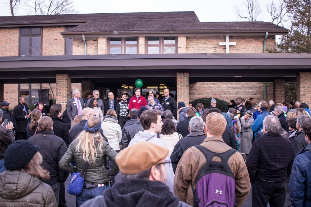 A crowd gathers around as several speakers address the people attending the event outside the All Saints Episcopal Church on March 5, 2018 at the Celebration of Diversity Festival. The festival was organized in response to Richard Spencer's alt-right event at the MSU Pavilion.