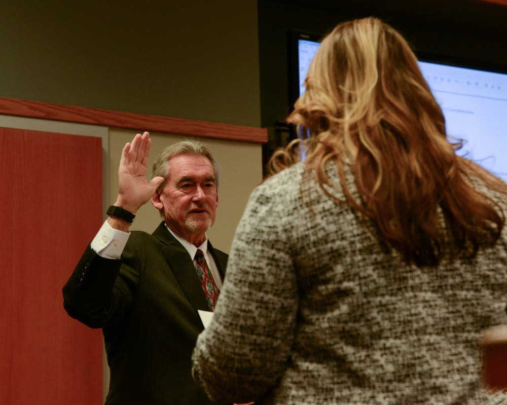 <p>Council Member Mark Meadows is sworn in during the East Lansing City Council meeting on Nov. 12, 2019 at the East Lansing City Offices.</p>