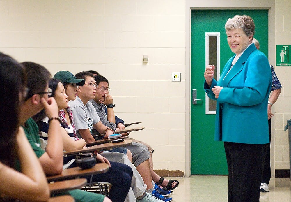 <p>President Lou Anna K. Simon speaks to students in the MSU-China Turf Grass Program on Wednesday at the Plant and Soil Sciences Building. The 72 Chinese students are at MSU for two weeks before starting internships across the country. Kat Petersen/The State News</p>