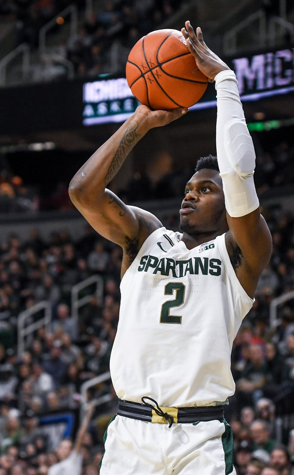 <p>Freshman guard Rocket Watts (2) shoots from deep during the game against Western Michigan Dec. 29, 2019 at the Breslin Center. The Spartans defeated the Broncos, 95-62.</p>