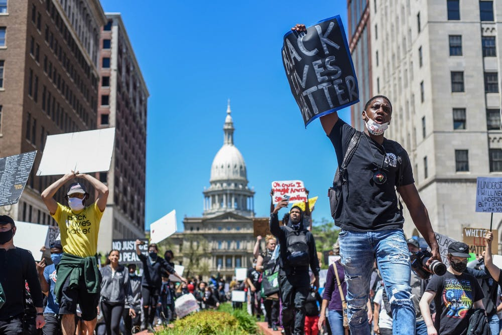 People march at the protest in Lansing against police brutality May 31, 2020.