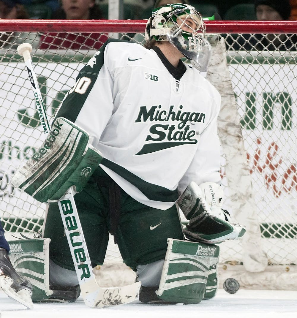 """<p> Sophomore goaltender Jake Hildebrand reacts after being scored on in the first period of the game against the U.S. National Team Development Program under 18 team on March 1, 2014, at Munn Ice Arena. The Spartans lost to the <span class=""""caps"""">USANTDP</span>, 4-3. Danyelle Morrow/The State News</p>"""