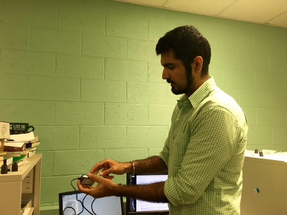 Graduate student Sunpreet Arora demonstrates finger printing on July 26, 2016  at the Pattern Recognition and Image Processing, or PRIP, lab. Photo courtesy of the Department of Computer Science and Engineering.