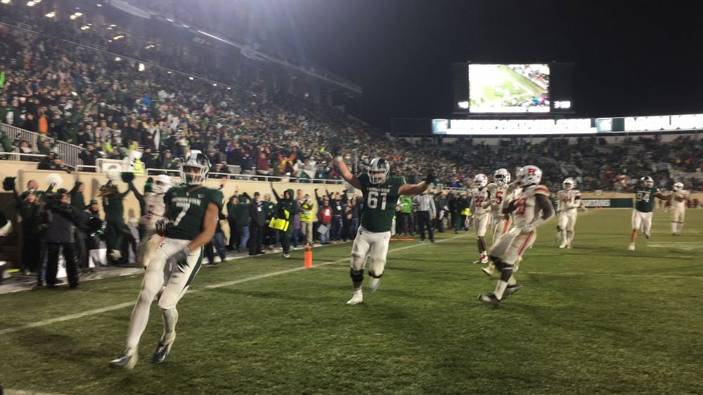 <p>Sophomore wide receiver Cody White (7) runs into the end zone during Michigan State's game against Rutgers at Spartan Stadium on Nov. 24, 2018. The Spartans beat the Scarlet Knights, 14-10.&nbsp;</p>