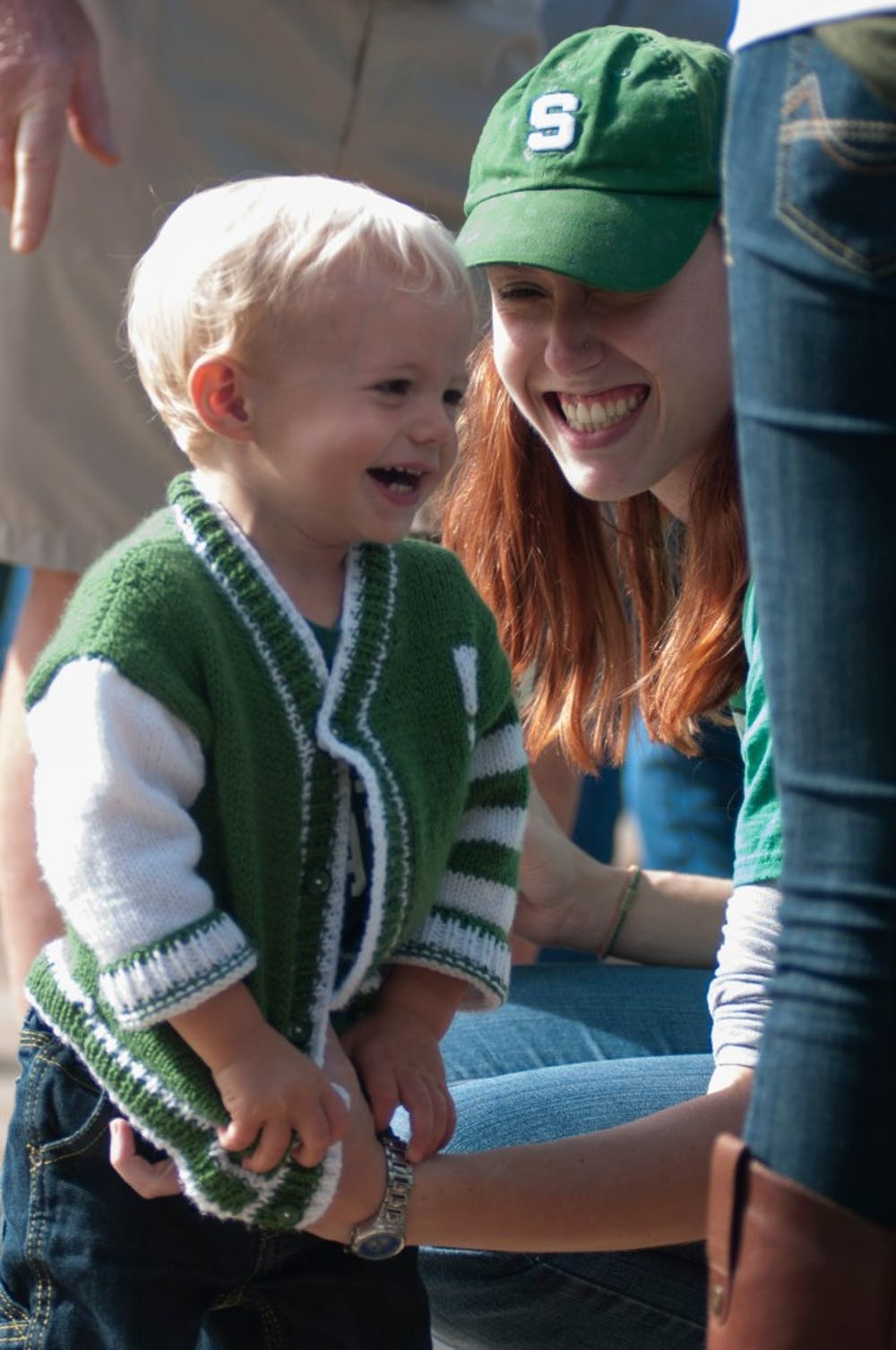 <p>Okemos resident Monica Herman and her son Ben, 1, tailgate before the game against Air Force on Sept. 19, 2015 at Munn Field. The Spartans defeated the Falcons, 35-21. Kennedy Thatch/The State News</p>