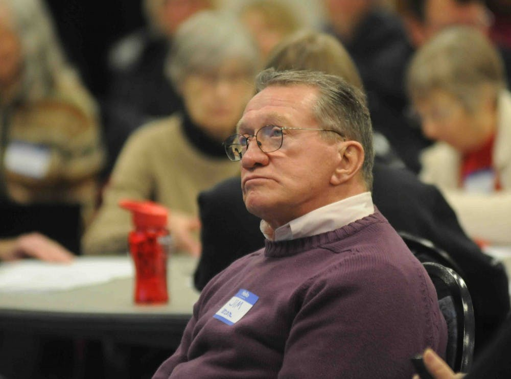 <p>East Lansing resident Jim Secor ponders the future of the East Lansing budget at a community meeting on Jan. 10, 2018, at the Hannah Community Center. (State News | Annie Barker)</p>