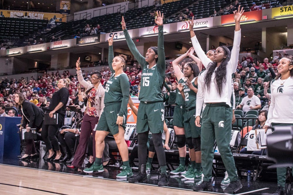 <p>The Spartans' bench watches as sophomore guard Taryn McCutcheon attempts a three-pointer during the game against Indiana on March 1, 2018 at Bankers Life Fieldhouse. The Spartans fell to the Hoosiers, 111-109, in 4OT.</p>