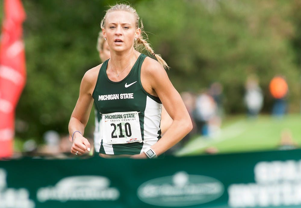 <p>Junior Leah O'Connor reaches the finish line the Spartan Invitational on Sept. 12, 2014, at Forest Akers East Golf Course, 2280 South Harrison Road, in East Lansing, Mich.  O'Connor finished first with a time of 21:03. Raymond Williams/The State News</p>