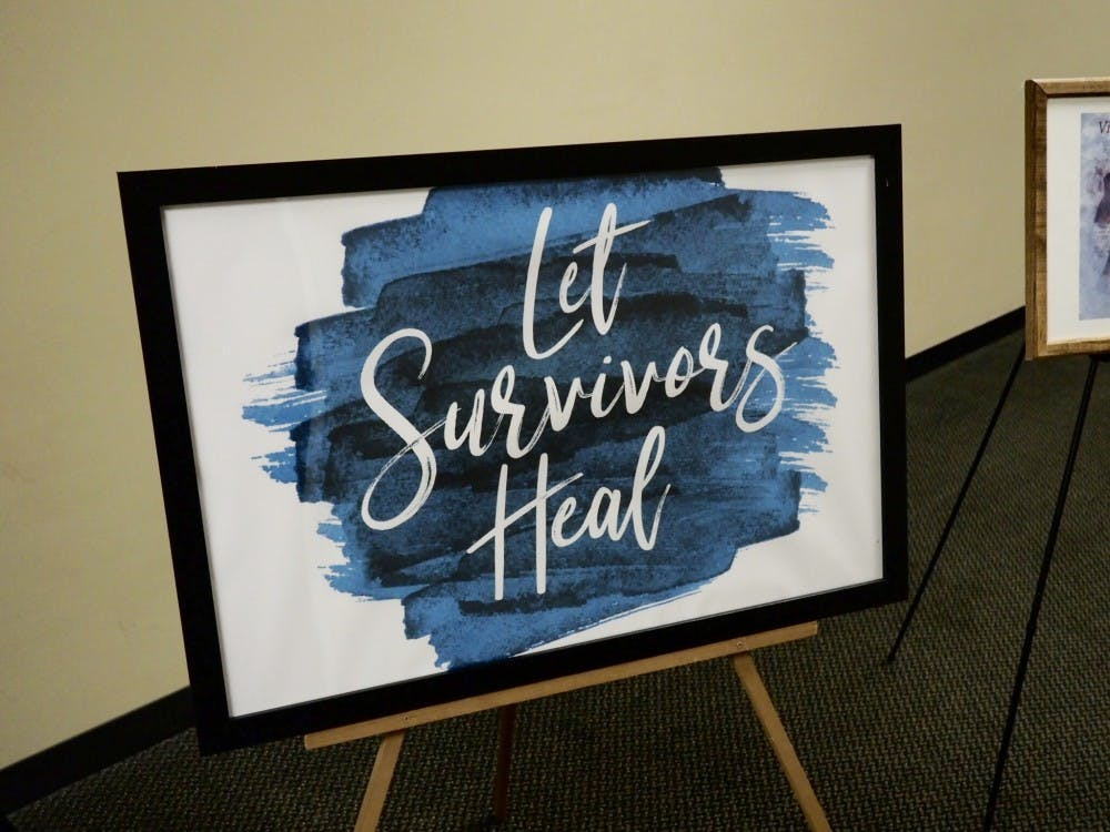 <p>A sign supporting survivors sits at the back of the room for the Teal Ribbon Ceremony at the 2019 Teal Ribbon Award and Volunteer Recognition Ceremony at the MSU Union on April 15, 2019.</p>
