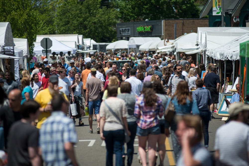 Festivalgoers roam around Albert Ave. during the 53rd annual East Lansing Art Festival on May 22, 2016 in East Lansing. The East Lansing Art Festival is ranked 50th in the nation in the Top 100 Fine Art Festival List by Sunshine Artist Magazine.