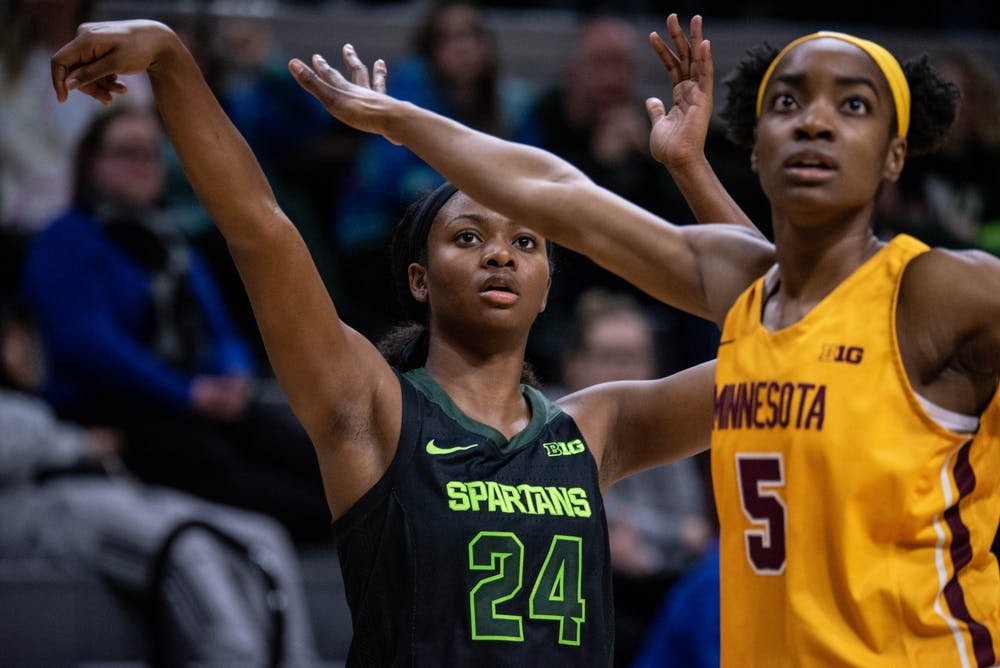 Sophomore guard Nia Clouden (24) holds a follow-through during the game against Minnesota Feb. 17, 2020 at the Breslin Center. The Spartans defeated the Golden Gophers, 66-54.