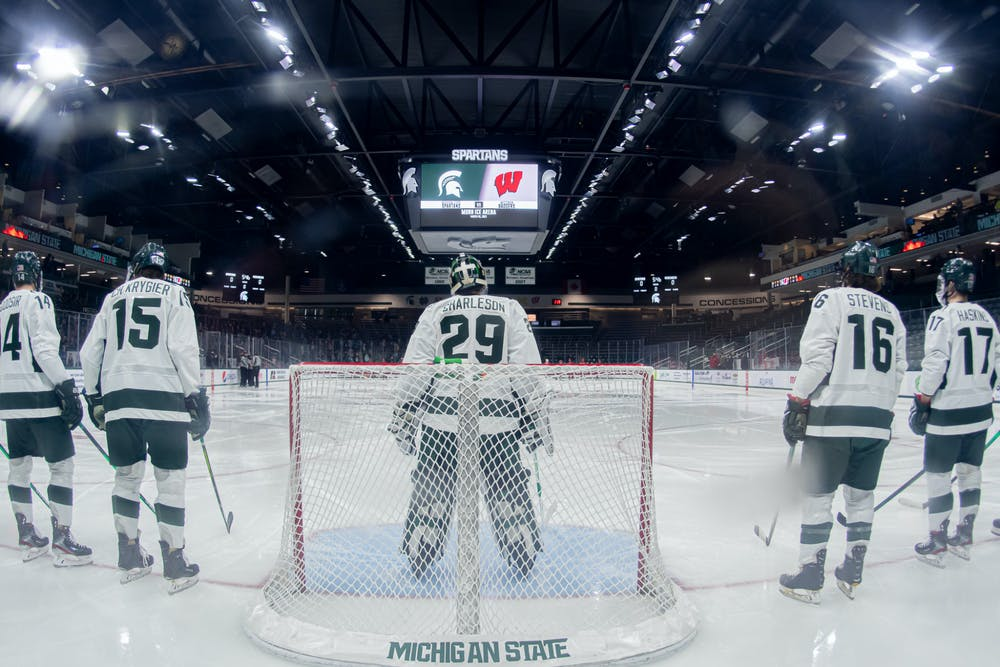<p>Then-freshman goalie Pierce Charleston and the Spartans line up on the ice for the National Anthem on Mar. 6, 2021. The Spartans fell 2-1.</p>