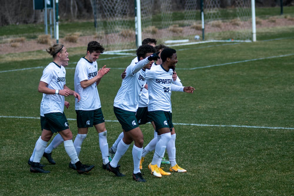 <p>Members of MSU men&#x27;s soccer celebrate after scoring their 3rd goal of the game against Wisconsin on March 31, 2021, at DeMartin Stadium in East Lansing, Michigan. </p>