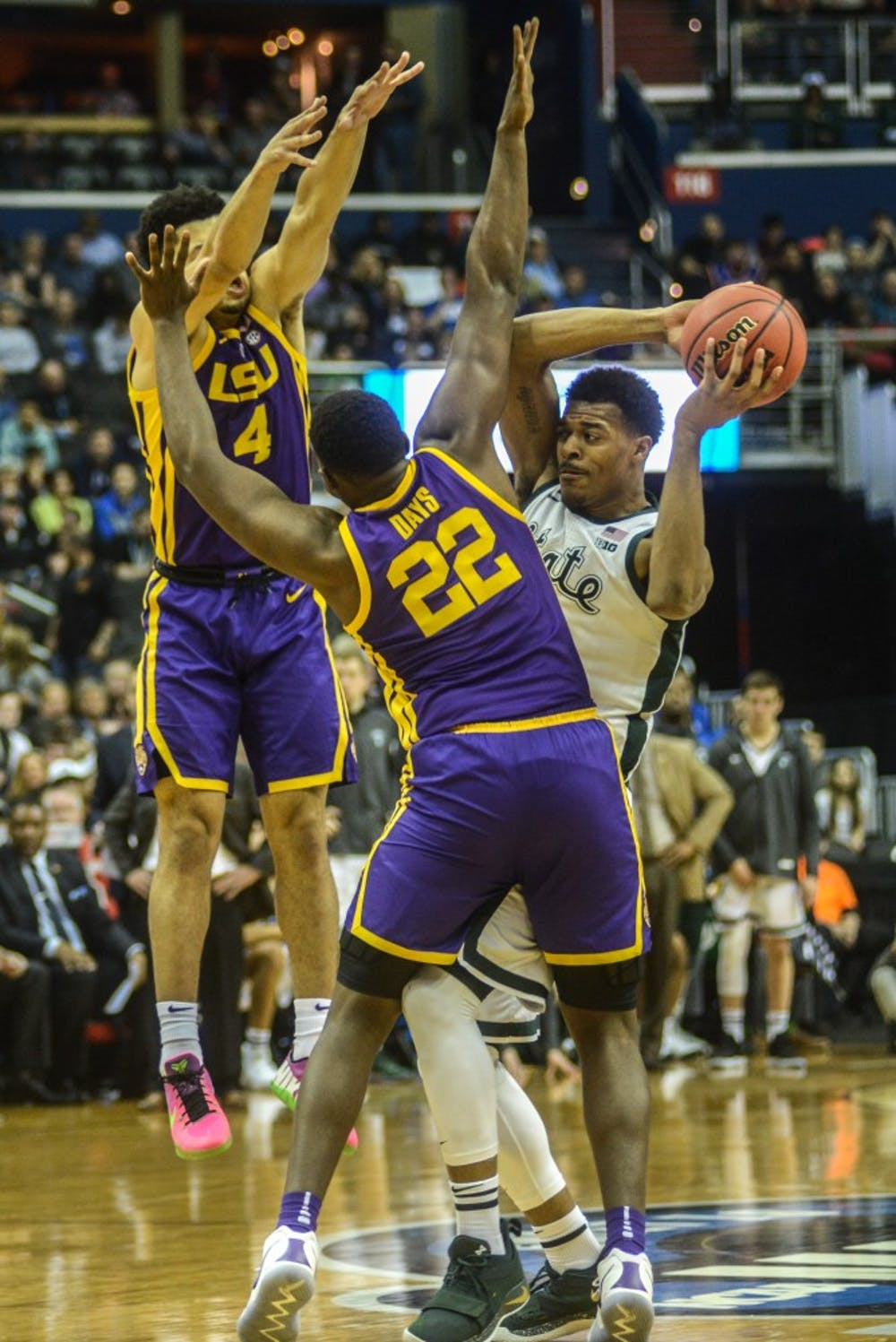 Sophomore forward Xavier Tillman (23) defends the ball against LSU's forward Darius Days (22) and guard Skylar Mays (4) during the game against LSU at Capital One Arena on March 29, 2019. The Spartans defeated the Tigers, 80-63.