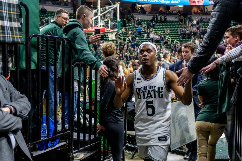 Senior guard Cassius Winston high-fives fans after a game against Maryland. The Spartans fell to the Terrapins, 60-67, at the Breslin Student Events Center on February 15, 2020.