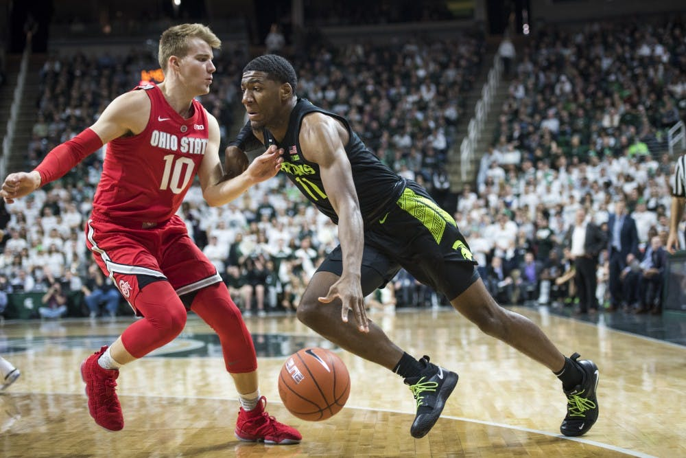 <p>Then-freshman forward Aaron Henry (11) drives to the net during the men's basketball game against Ohio State on Feb.17, 2019, at Breslin Center.</p>