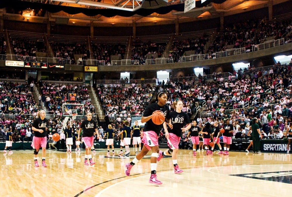 The Lady Spartans warm up before playing against Michigan Sunday afternoon at Breslin Center. The game drew a sold out crowd, a first for the Women's Basketball program. Matt Hallowell/The State News