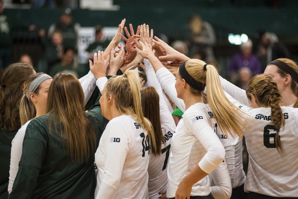 The Spartan volleyball team huddles up after winning the first round of the NCAA Championship against Fairfield University on Dec. 2, 2016 at Jenison Field House. The Spartans defeated the Stags, 3-0.