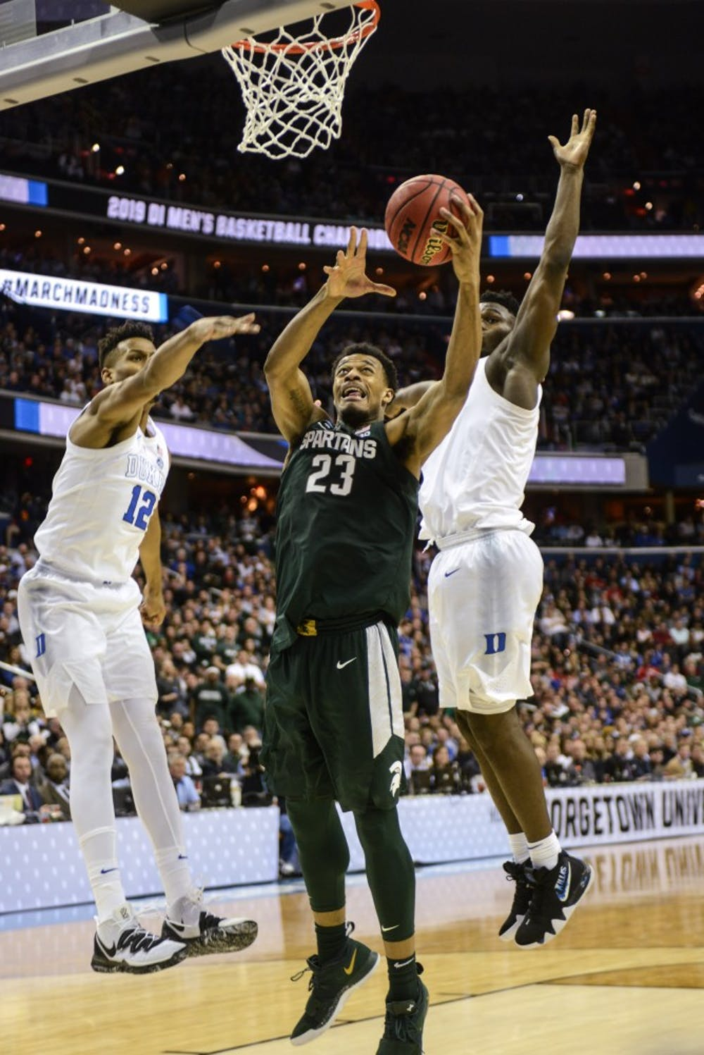 <p>Sophomore forward Xavier Tillman (23) shoots the ball during the game against Duke on March 31, 2019 at Capital One Arena. The Spartans defeated the Blue Devils, 68-67. The Spartans are the East Regional Winners and are headed to the Final Four.</p>