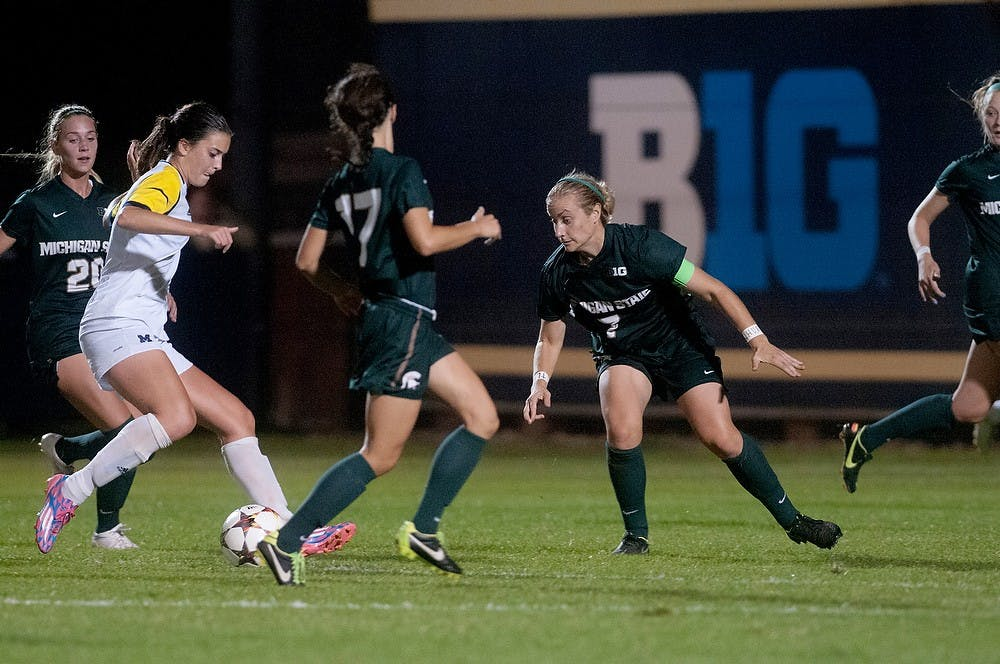 <p>Junior defender Mary Kathryn Fiebernitz, 7, looks to steal the ball from Michigan midfielder/forward Ani Sarkisian on Sept. 27, 2014 at the U-M Soccer Stadium in Ann Arbor, Mich. The Wolverines defeated the Spartans, 2-1. Jessalyn Tamez/The State News</p>