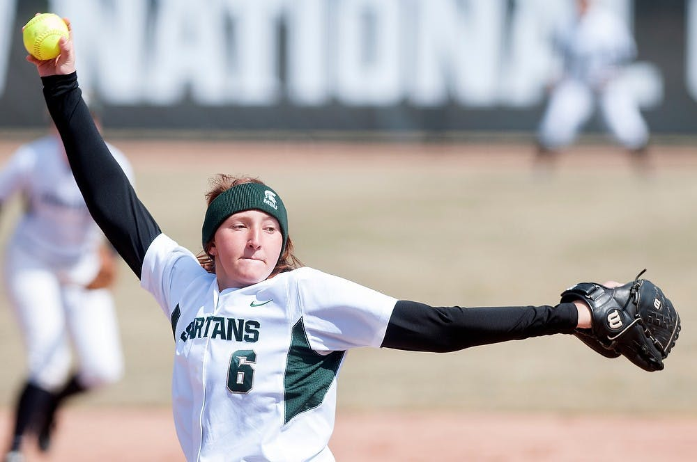<p>Junior pitcher Kelly Smith pitches during a game against Indiana on March 31, 2013, at Secchia Stadium at Old College Field. The Spartans won, 2-1. Julia Nagy/The State News</p>