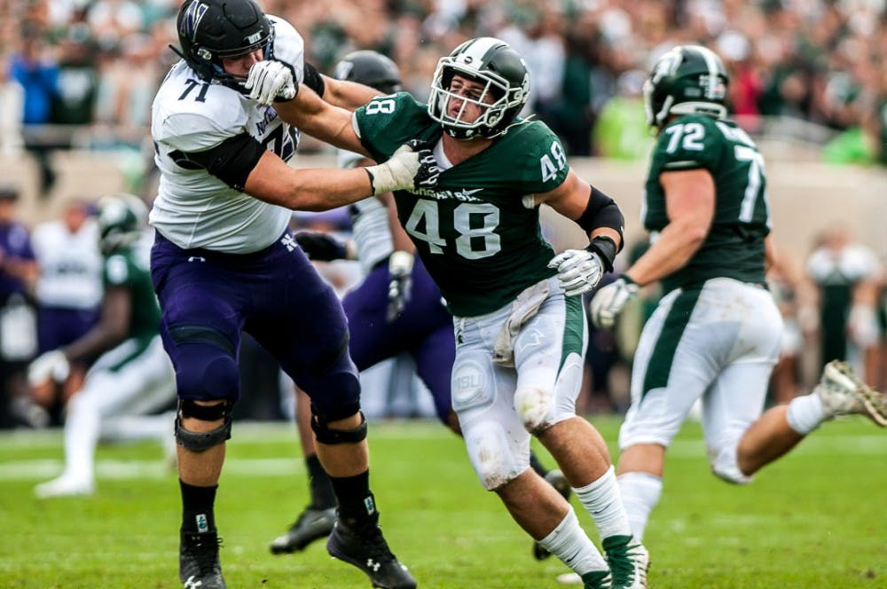 <p>Junior defensive end Kenny Willekes (48) collides with Northwestern&#x27;s senior lineman Tommy Doles (71) during the game against Northwestern on Oct. 6, 2018 at Spartan Stadium. The Wildcats led the Spartans, 14-6 at halftime. </p>