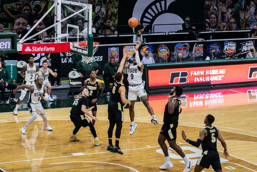 Junior forward Aaron Henry takes a midrange shot during the Spartans' 55-54 loss to Purdue on Jan. 8, 2021.