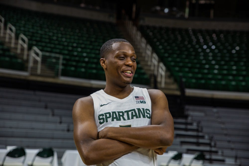 Senior guard Cassius Winston (5) laughs during MSU basketball media day on Oct. 15, 2019 at the Breslin Center.