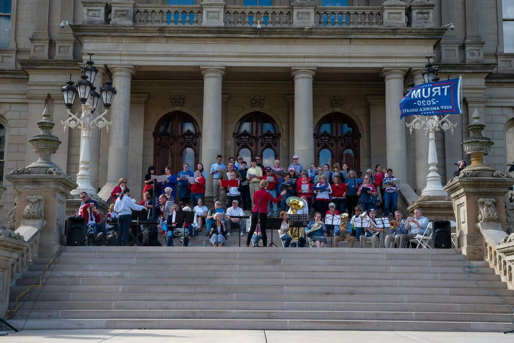 <p>Stand Up church&#x27;s children&#x27;s choir singing &quot;Amazing Grace&quot; at Stand Up Michigan freedom rally on Thursday, Oct. 8, 2020. (Di&#x27;Amond Moore) </p>