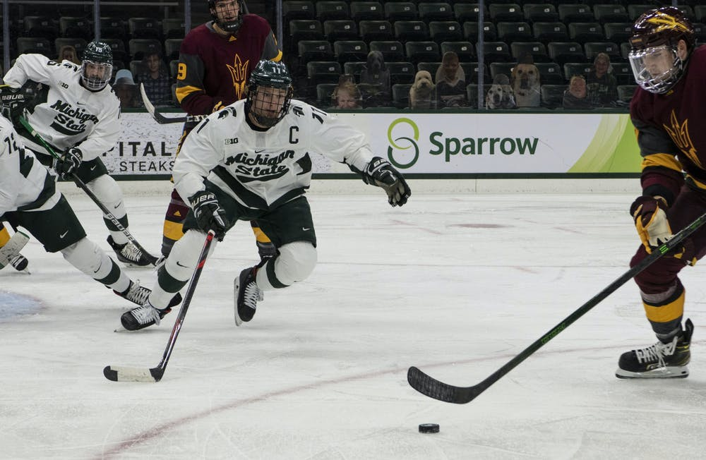 <p>Senior center Tommy Apap (11) charges an Arizona State player during the first period. The Spartans triumphed against the Sun Devils, 2-0, on Nov. 20, 2020.</p>