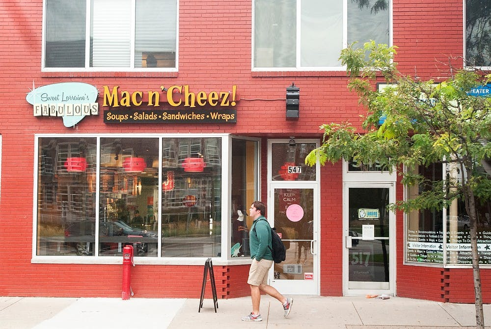 A pedestrian walks past Sweet Lorraine's Fabulous Mac N' Cheez restaurant on Sept. 15, 2014. Raymond Williams/The State News