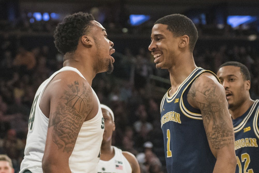 Sophomore forward Nick Ward (44) addresses Michigan guard Charles Matthews (1) during the first half of the 2018 Big Ten Men's Basketball semifinal game against Michigan on March 3, 2018 at Madison Square Garden in New York. (Nic Antaya | The State News)