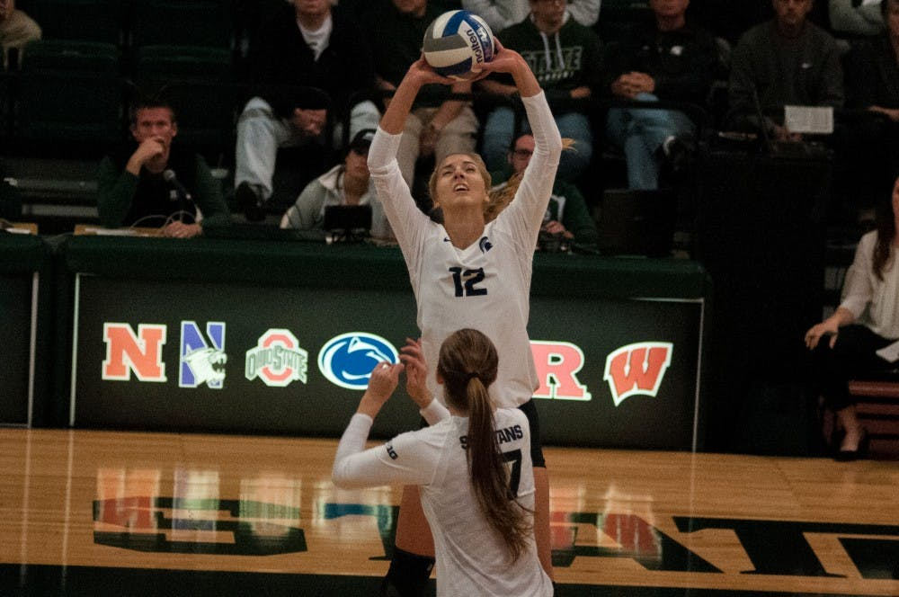 Junior setter Rachel MInarick (12) sets the ball during the game against Maryland on Oct. 8, 2016 at Jenison Field House.  The Spartans defeated the Terrapins, 3-1.