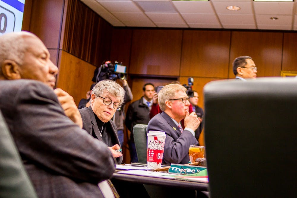 President Simon listens to victims speak during a board of trustees meeting on Dec 15, 2017 at the Hannah Administration Building. Protesters gathered to address the misconduct of MSU's handling of the Larry Nassar investigation.