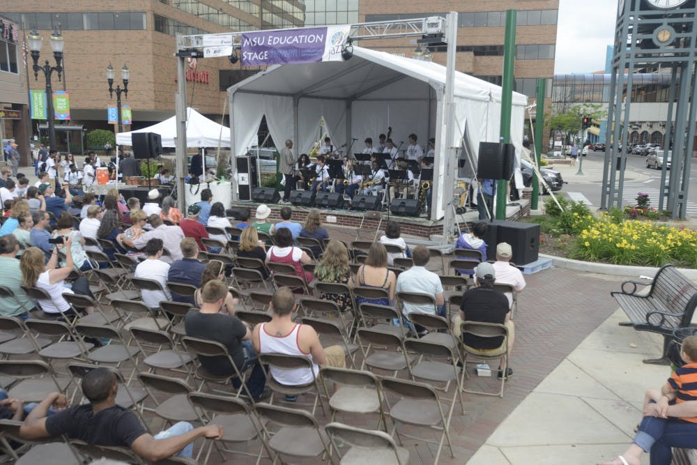 <p>The Michigan State University Big Band Symposium performs during the East Lansing Summer Solstice Jazz Festival at Ann Street Plaza June 19th. 2015. Wyatt Giangrande/The State News</p>
