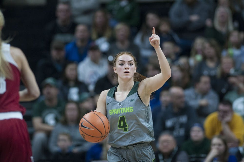 <p>Sophomore guard Taryn McCutcheon (4) brings the ball up the court during the first half of the women's basketball game against Indiana on Jan. 20, 2018 at Breslin Center. The Spartans trailed in the first half, 45-32. (C.J. Weiss | The State News)</p>