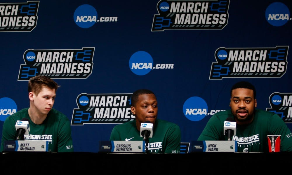 From left to right, senior guard Matt McQuaid (20), junior guard Cassius Winston (20) and junior forward Nick Ward (44) respond to questions during a press conference at Wells Fargo Arena March 22, 2019.during a press conference at Wells Fargo Arena March 22, 2019.