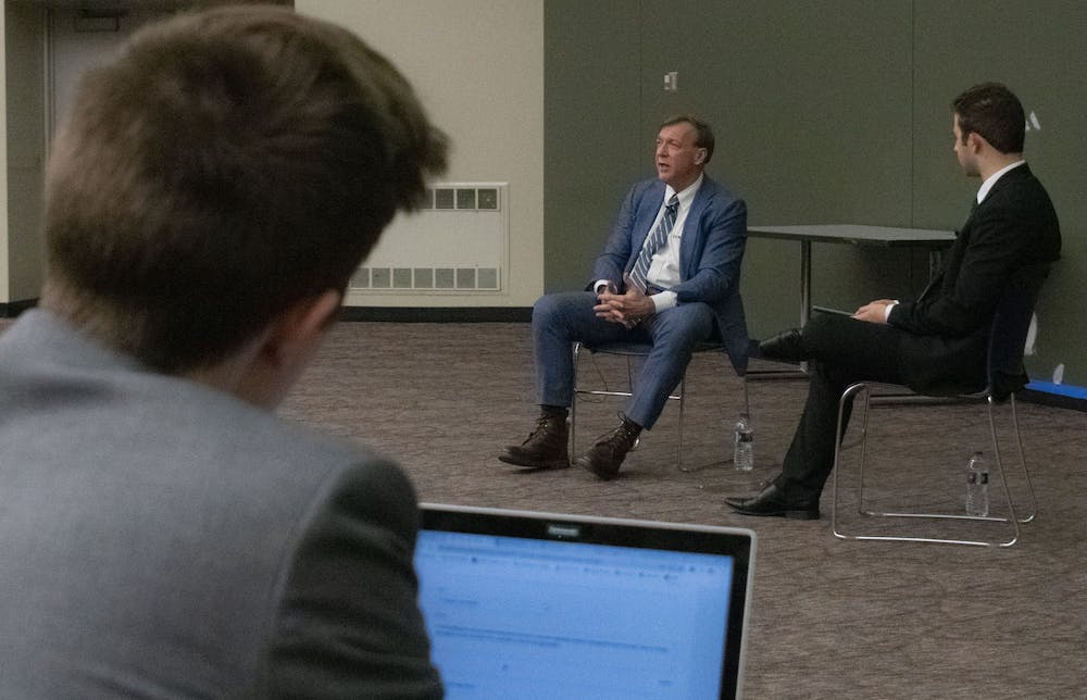 <p>A student watches President Stanley intently as he answers his question about new intramural facilities in the future. Students gathered to ask President Stanley questions about university related topics during the Ask Stanley Q&amp;A hosted in the Business College Complex on Feb. 18, 2020.</p>