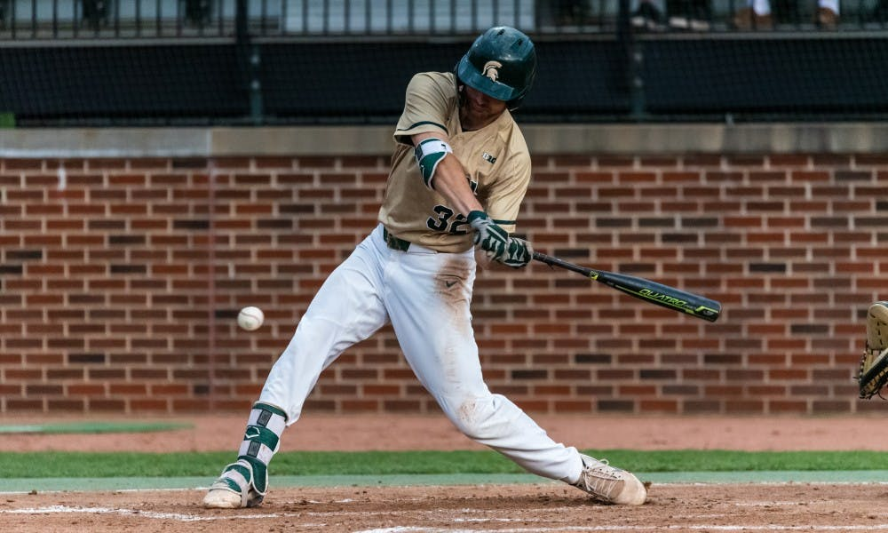 <p>Sophomore infielder Zach Iverson (32) swings at a pitch. The Spartans beat the Fighting Illini, 5-2, on May 17, 2019 at McLane Baseball Stadium.</p>