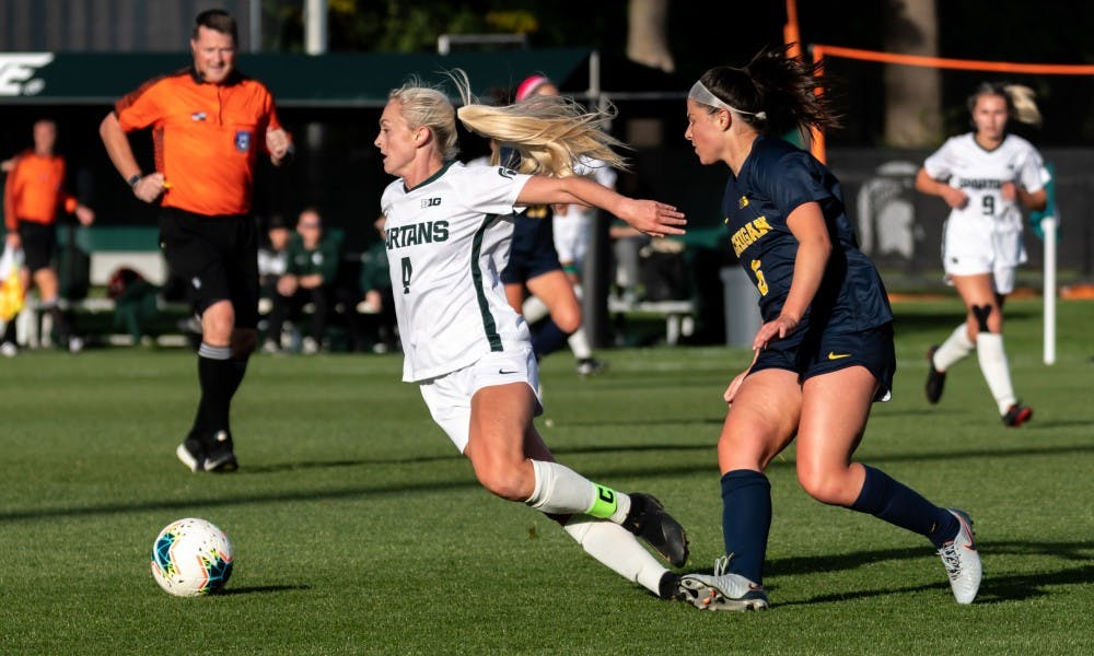 <p>Then-senior midfielder Brooke Cilley (6) tripped then-senior defensive midfielder Michaela Kovacs (4).The Wolverines defeated the Spartans at DeMartin Soccer Stadium, 3-2, on Oct. 19, 2019. </p>